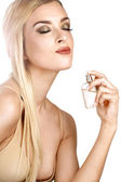 Elegant woman applying perfume on her body — Stock Photo