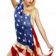 American girl cover herself with a big american flag — Lizenzfreies Foto