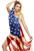 American girl cover herself with a big american flag — Fotografia Stock
