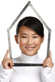 Young happy asian chinese woman make an house symbol — Stockfoto