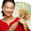 Beautiful chinese girl with traditional homemade umbrella — Stock Photo #37460901