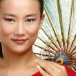Beautiful chinese girl with traditional homemade umbrella — Stock Photo #37461063