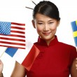 Beautiful asian woman showing multicolor international flags — Stock Photo