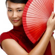 Traditional asian woman holding a red beautiful fan — Stock Photo