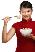 Chinese woman showing asian food using chopstick — Stock Photo