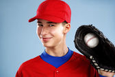 Portrait of a beautiful teen baseball player in red and white un — Photo