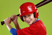 Portrait of a beautiful teen baseball player in red and white un — Stock Photo