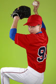 Portrait of a beautiful teen baseball player in red and white un — Stockfoto