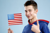 Young smiling male student teenager holding a flag — Foto de Stock