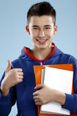 Young smiling male student teenager holding a book — Stock Photo
