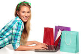 Young Woman Sitting at the desk  shopping Online — Stock Photo