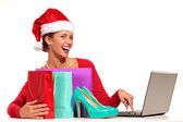 Christmas woman on laptop doing internet shopping — Stock Photo