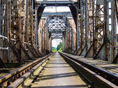 Rail length across the river on steel bridge — Stock Photo