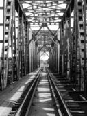 Rail length across the river on steel bridge — Stock Photo