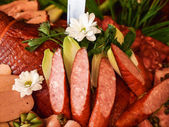 Sausage on wooden table with knife in wedding party — Stock Photo
