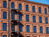 Historic factory building style — Stock Photo