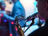 Saxophone player on concert, profile — Stock Photo