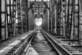 Rail length across the river on steel bridge, black and white ph — Stock Photo