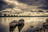 Old boats on the river, stormy weather — Stock Photo