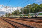 Passenger train at a railway station at summer — Stock Photo