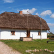 Old rural wooden white house, open-air museum, Poland — Stock Photo #41478583
