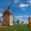 Wooden Polish windmill over clear blue sky — Stock Photo #41479749