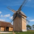 Wooden Polish windmill over clear blue sky — Stock Photo #41479775