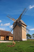 Wooden Polish windmill over clear blue sky — Stock Photo