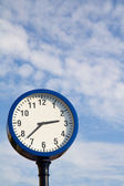 A clock with the sky as background — Stock Photo