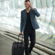 Young Caucasian Man Walking in City with Cell and Suitcase — Stock Photo