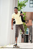 Skateboarding with bag — Stock Photo