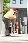 Picking up skateboard — Stock Photo
