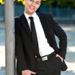 Young businessman relaxing in the park — Stock Photo