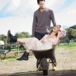 Beautiful Girl Enjoying Being Pushed in Wheelbarrow — Stock Photo