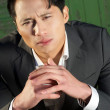 Thoughtful Asian Businessman Portrait — Stock Photo