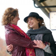 Friendly Hug at Train Station - Stock Photo