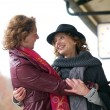 Stock Photo: Friendly Hug at Train Station