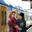 Friends Greeting Each Other at the Train Station - Stock Photo