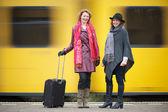 Friends and Speeding Train — Stock Photo