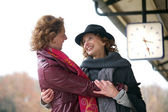 Friendly Hug at Train Station — Stock Photo