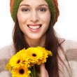Smiling Young Woman with Yellow Flowers — Stock Photo
