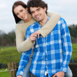 Young Couple Smiling Outdoors — Stock Photo