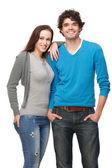 Pojkvän och flickvän ler i studio — Stockfoto
