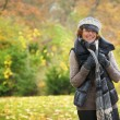 Smiling woman in the Park - Stock Photo