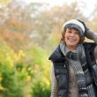 Smiling Woman and Winter Hat — Stock Photo #18729897