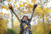 Beautiful Middle Aged Woman Throwing Yellow Leaves — Stock Photo