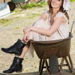 Beautiful Bride Sitting in Wheelbarrow — Stock Photo