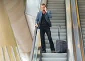 Businessman on Escalator — Stock Photo