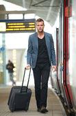 Businessman Walking at Train Station — Stock Photo