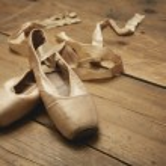 Ballet Shoes on Wooden Floor — Stock Photo #21801455